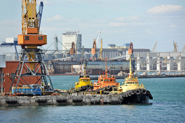 Tugboat and freight train under port crane, Odessa, Ukraine