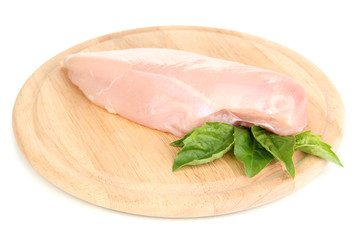 Raw chicken fillets on wooden board, isolated on white