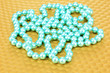 Color beads on bright background, close-up