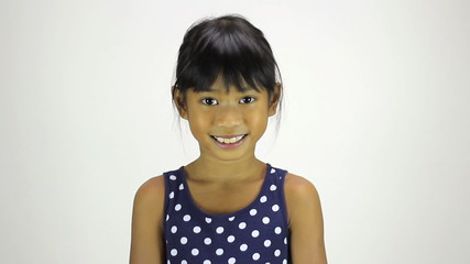 Confident Little Asian Girl Smiles At Camera