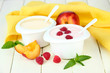 Delicious yogurt with fruit and berries on table close-up