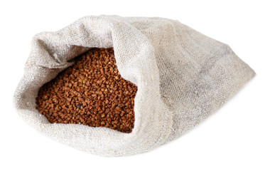 Cloth bag with buckwheat isolated on white