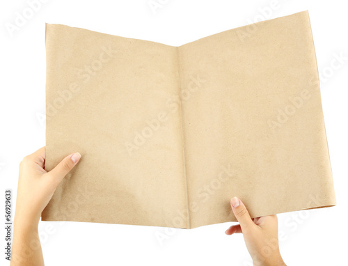 Newspaper in hands isolated on white
