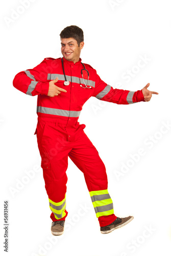 Cheerful paramedic pointing