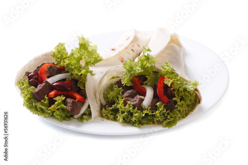 Fajitas on a plate isolated on white background