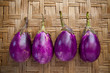 purple eggplant on bamboo craft