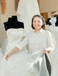 Shop assistant shows bridal dress