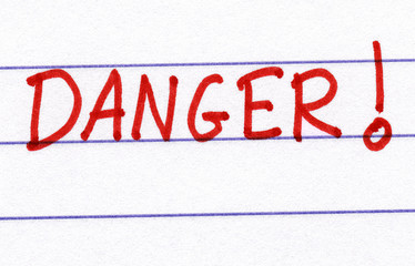 Danger, written in red ink on white paper.