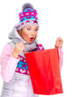 Surprised woman looking on the gifts in bags after shopping