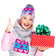 Photo of happy woman with a gift in a winter outerwear