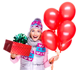Fun happy young woman with red gift box and balloons
