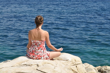 Meditating on a seacoast
