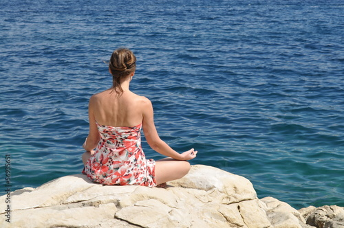 Meditating on a seacoast