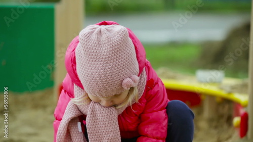 Close-up of a cutie playing in a sandpit