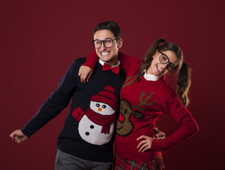 Portrait of nerd couple wearing funny sweaters
