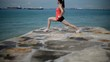 Asian Woman doing yoga poses by the sea