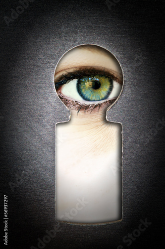 canvas print picture Observation  - eye looking through a keyhole