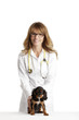 Spaniel puppy in front of a veterinarian doctor