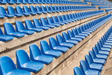 empty plastic blue seats on football stadium