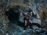 cavewoman hunting with spear