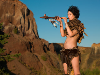 indigenous woman smoking from peace pipe