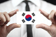 Businessman holding a business card with South Korea Flag