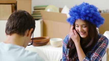 Girl wearing blue wig and guy with huge eyes