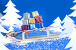 Christmas gifts on the sled abstract concept