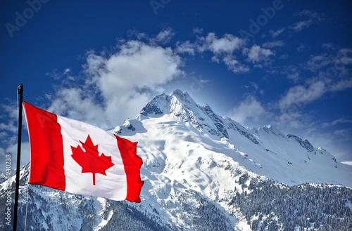 Leinwandbild Motiv Canadian flag and beautiful mountain landscape