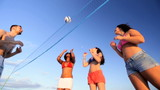 Carefree Young People Vacation Beach Volleyball