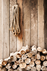 Wood planks put on wood wall and lead rope