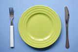 green plate on blue