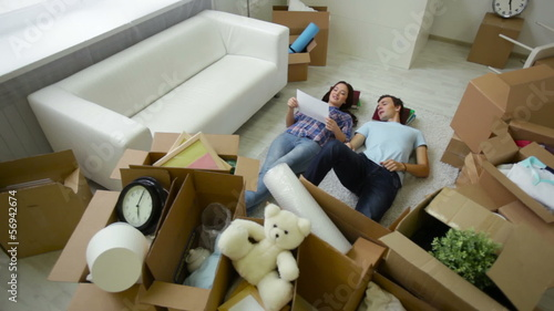 young people lying among belongings
