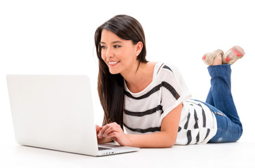 Woman browsing on a laptop