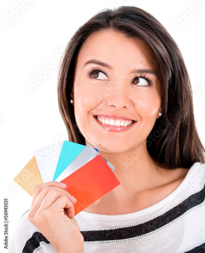 Pensive woman with credit cards