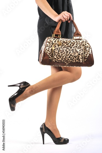Woman legs with shoes and bag