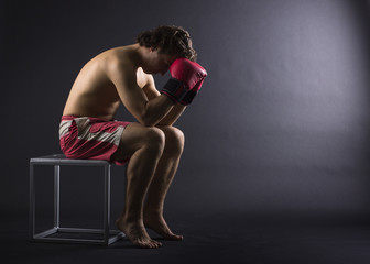 Boxer man concentrating on dark background