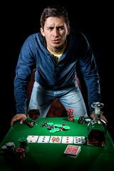 Agressive young gambler indoors