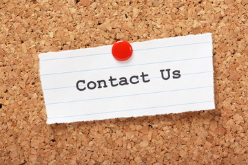 Contact Us Note pinned to a cork notice board