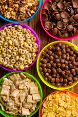 various kids cereals in plastic bowls