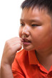 Worried young Asian boy biting his fingernail