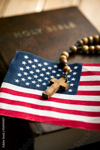 holy bible with american flag and crucifix