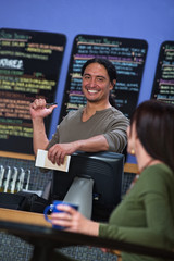 Cute Cafe Worker Pointing at Menu