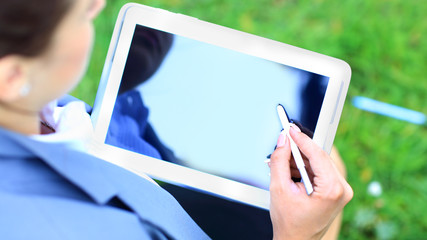 Woman's hand touching screen on modern digital tablet pc