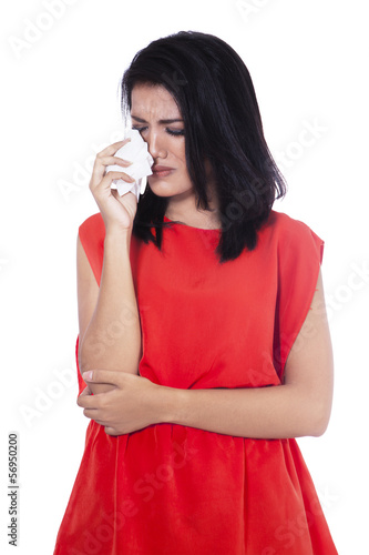 Beautiful woman is crying and holding handkerchief