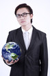 Businessman hold globe - isolated