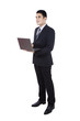 Businessman using laptop isolated on white