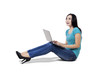 Casual woman using laptop sitting on floor