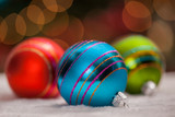 Colorful ornaments under a Christmas tree