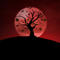 Halloween pumpkin tree on red background